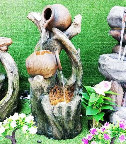 waterfall fountain with pot